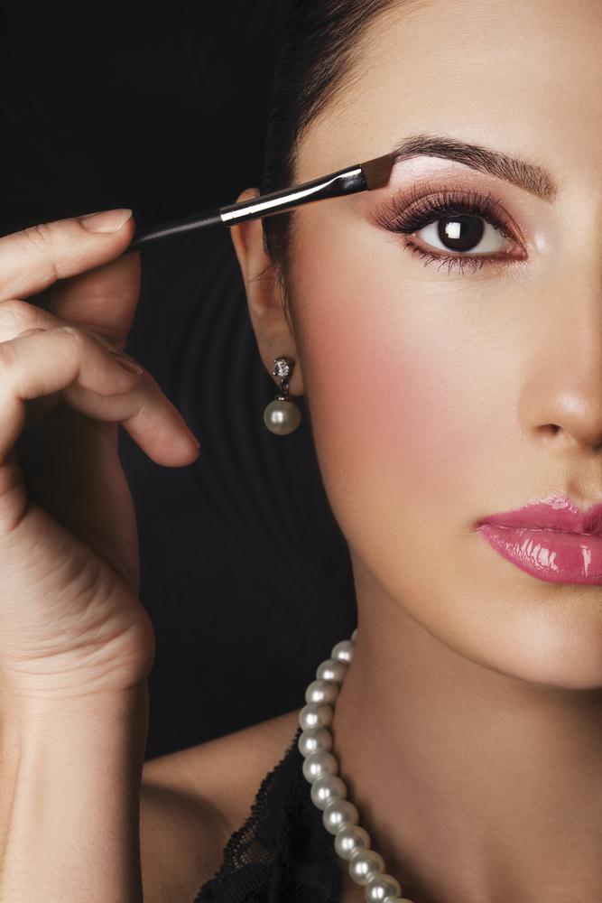 né di quest'altra espressione così concentrata (per di più con un makeup già completo! :D)